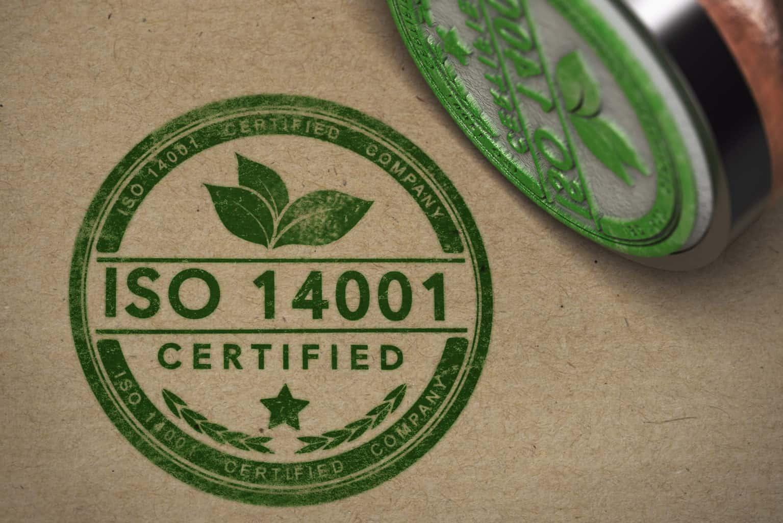 Grønt ISO 14001 stempel på papir